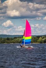 Men Sailing On A Catamaran