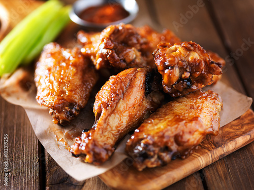 barbecue chicken wings close up on wooden tray Canvas Print