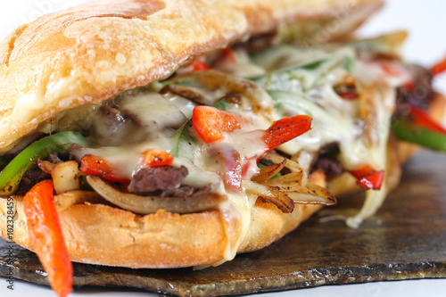 Keuken foto achterwand Steakhouse Tasty beef steak sandwich with onions, mushroom and melted provolone cheese in a ciabatta