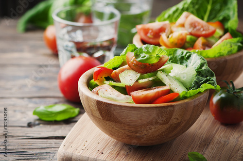 Concept of healthy food: salad with tomato and cucumber