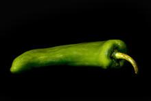 Single Green Pepper On Black
