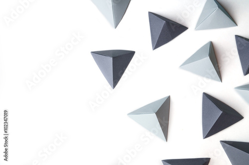 Fotografia  Creative abstract background with black and gray origami pyramids  with free copy space on the left side