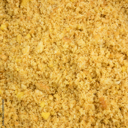 Fotografie, Obraz  The close up of graham cracker crust mix with melted butter for pie or tart baking