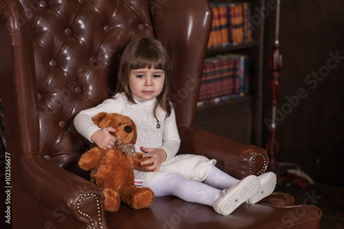 Valokuva  An adorable 2-year-old girl is sad