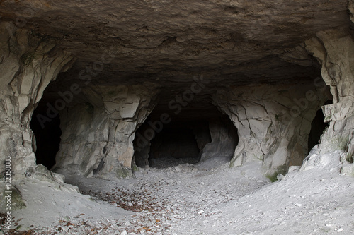 stone cave inside. view near the entrance Fototapet