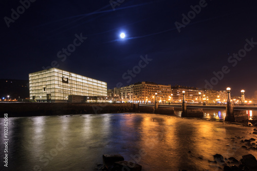 Photo  Night view of the Palace of Congress, Kursal,  with the moon in the sky, in San