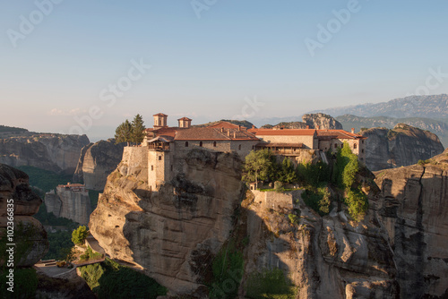 Poster The Holy Monastery of Varlaam in Meteora - complex of Eastern Orthodox monasteries at sunrise, Greece