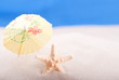 starfish on the beach under an umbrella