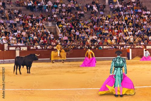 MADRID, SPAIN - SEPTEMBER 18: Matador and bull in bullfight on S