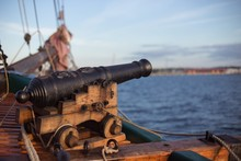 Old Wooden War Ship With A Cannon