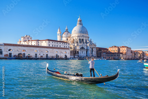 Obraz na plátne Grand Canal and Basilica Santa Maria della Salute with gondolier in Venice, Ital
