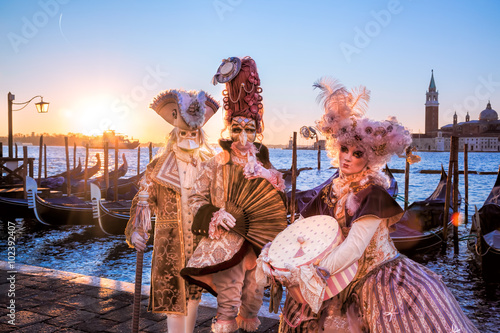 Carnival masks against sunrise in Venice, Italy