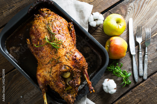 Roasted goose with apples in a rustic style Fototapeta