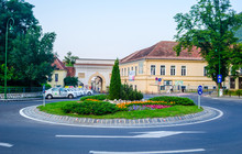 View Of A Small Roundabout With An Ancient Poarta Schei Gate Leading To The Old Town Of Romanian City Brasov.