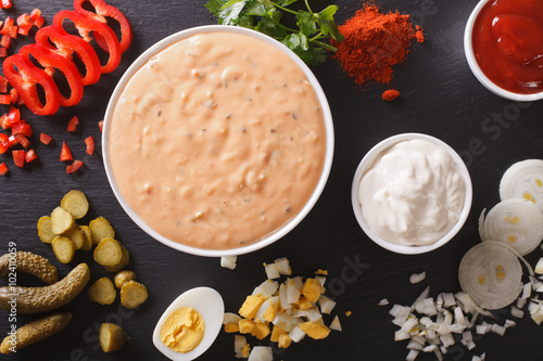 Thousand Island Dressing with ingredients close-up. horizontal top view