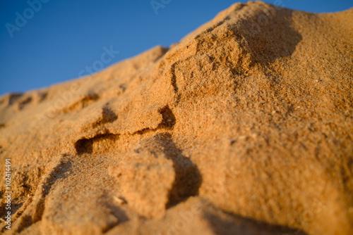 Desert, sandy barkhans over background of blue sky Canvas Print