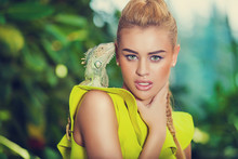 Portrait Of Young Woman With Iguana