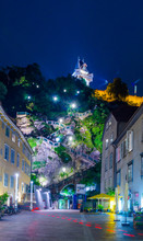 Night View Of An Illuminated Staircase Leading To The Schlossberg Castle In The Austrian City Graz