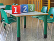 bins with large numbers on the desk in the kindergarten