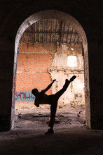 Silhouette Of Man Doing Martial Arts