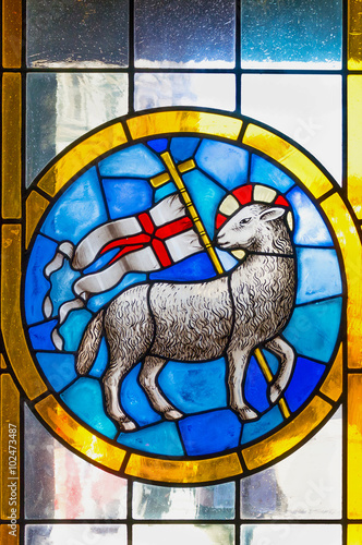 The Lamb of God. Stained glass church window detail.