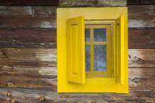 Yellow Window On Wooden House