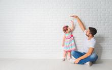 Concept. Dad Measures Growth O...