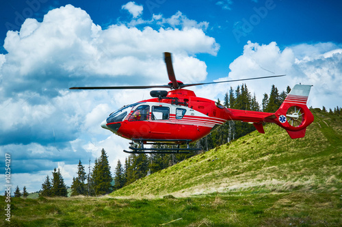obraz dibond Helicopter takeoff in the mountains