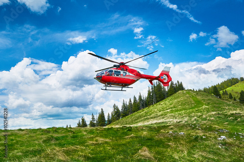 fototapeta na drzwi i meble Helicopter takeoff in the mountains