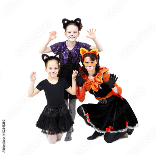 Young Woman And Two Girls In Cat Carnival Costumes Posing Buy This