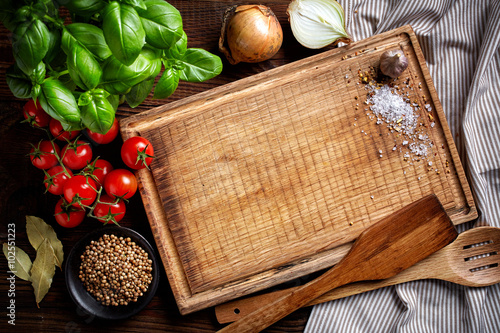 Keuken foto achterwand Koken cooking background with old cutting board