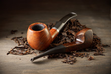 Pipes On Tobacco Pile