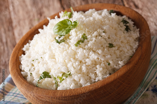 Fotografie, Obraz  Cauliflower rice with basil in a bowl close-up. horizontal