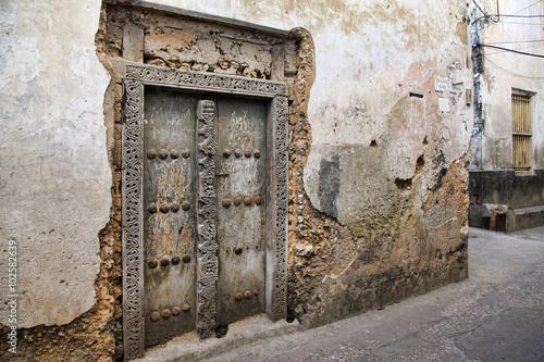 Deurstickers Zanzibar Old wooden door at Stone Town