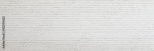 Tuinposter Baksteen muur Brick wall painted with white paint.