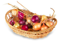 Bunch Of Beige And Purple Onions In Wicker Basket
