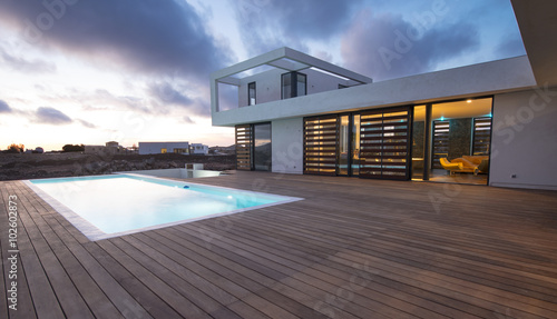 Luxury modern home with backyard swimming pool - 102602873
