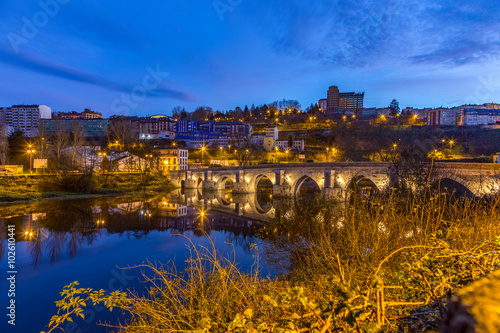 The Roman Bridge in Lugo during blue hour at the Camino Primitivo, a World Heritage