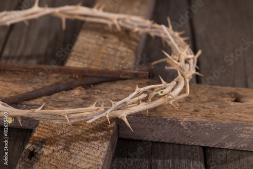 Fotografie, Obraz  Crown of Thorns and Nails on a Rustic Wooden Cross