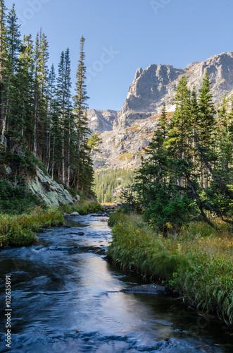 Fotografering  Creek Runs Beneath the Little Matterhorn in Colorado