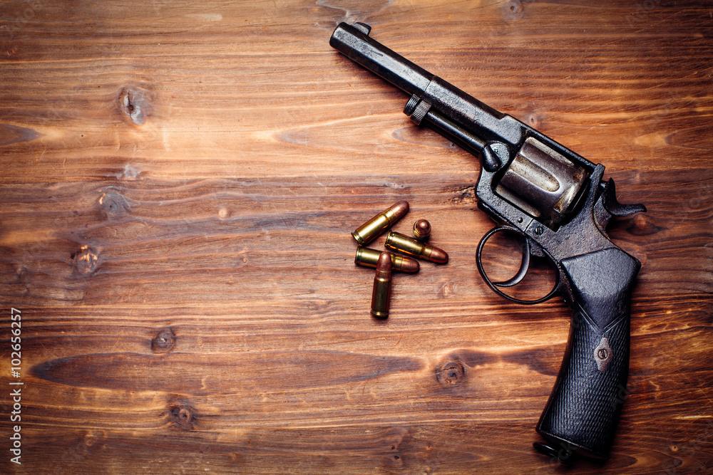 Fototapeta Vintage pistols on wooden background
