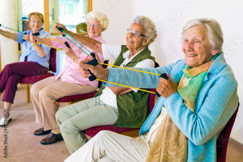 Fotografie, Obraz  Cheerful senior women exercising their arms.