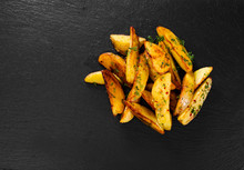 Potato Wedges On Black Backgro...