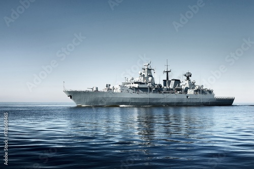 Large grey modern warship sailing in still water Fotobehang