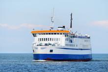 Ferry Sailing In The Bright Su...