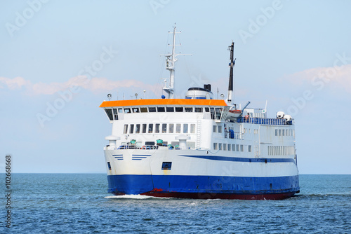 Ferry sailing in the bright sunny day Wallpaper Mural