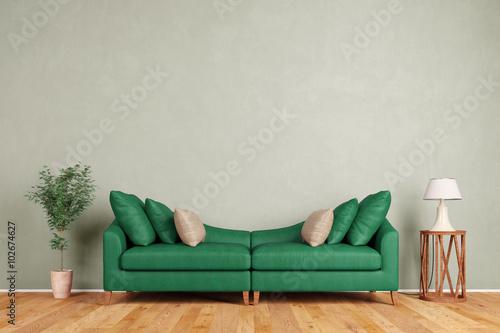 Fotografia  Grünes Sofa vor Wand im Wohnzimmer