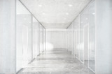 Fototapeta Perspektywa 3d - Long corridor with concrete floor and transparent walls in moder