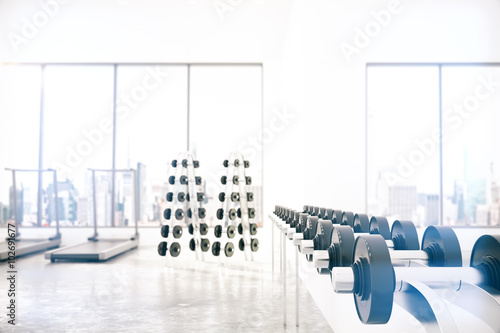 Foto op Plexiglas Fitness Empty light gym room with Gym interior with dumbbells and treadm