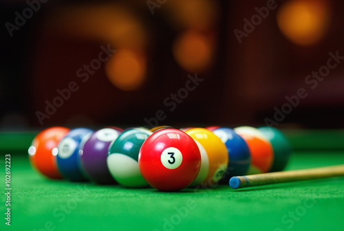 Foto Billiard balls in a green pool table
